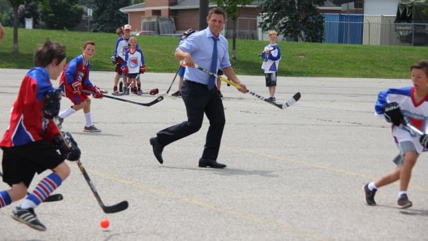 Ontario PC leader Patrick Brown, playing a game of pickup street hockey game at The Aud Tuesday afternoon in Kitchener.