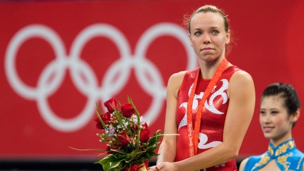 After winning three medals over four Olympic Games, Canadian trampoline star Karen Cockburn announced her retirement on Sunday.