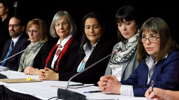 MMIWG inquiry commissioners (left-right) Brian Eyolfson, Marilyn Poitras, Marion Buller (chief commissioner), Michele Audette and Qajaq Robinson, along with lead legal counsel Susan Vella, speak with reporters in Ottawa on Feb. 7. Poitras resigned from the inquiry commission on Tuesday.