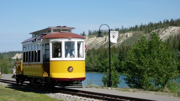 Passengers on the 1925 Whitehorse Trolley are told about some of the area's history as they ride along the downtown waterfront.