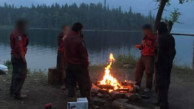 A photo posted on Facebook in early July appears to show a group of firefighters around a campfire in fire-ravaged Interior B.C.