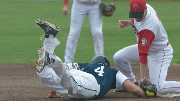 Safe or out? Team Canada beat Team USA in round robin play on July 9.
