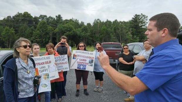 Mohawk leader Ellen Gabriel, far left, listens to Oka Mayor Pascal Quevillon during a protest Wednesday at the site of the Collines D'Oka housing development.