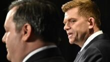 Wildrose leader Brian Jean (right) is criticized for promoting unity deal