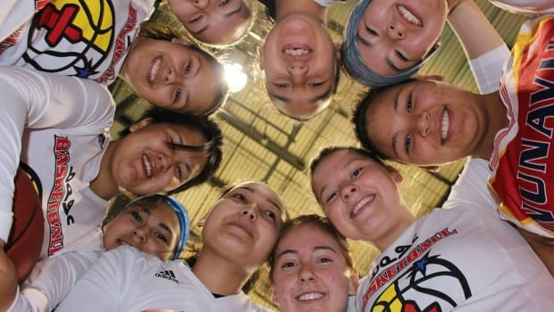 Nunavut's women's basketball team poses for a photo at the 2014 North American Indigenous Games. This year, 44 athletes will represent the territory at NAIG, including representatives from 11 communities.