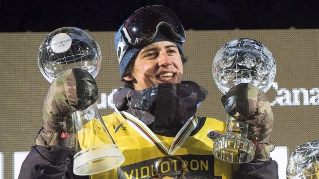 Mark McMorris of Regina, Sask., raises his Crystal Globes at the FIS Snowboard World Cup Big Air event in downtown Quebec City on February 11, 2017.