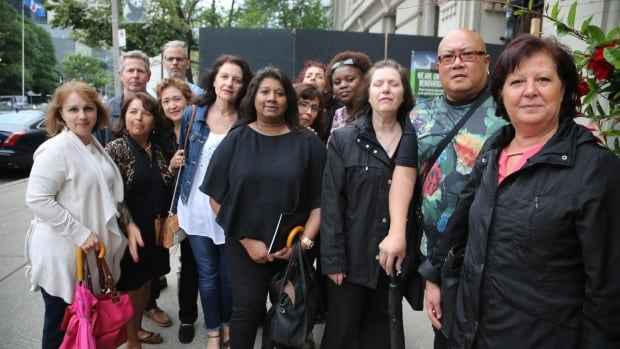 Sears Canada employees stand outside the Ontario Superior Court of Justice on Thursday.