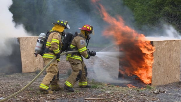 Firefighters test out the new Eco-Gel extinguishing foam on a controlled fire.
