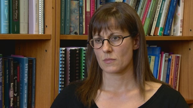 Law professor Erin Nelson says Health Minister Sarah Hoffman's reason for cancelling funding to a controversial private health foundation isn't supported by her ministry's own grant agreement.