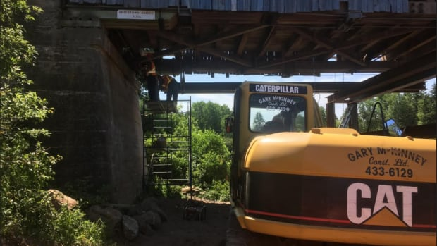 Workers reinforce Hammond River #3 covered bridge at Smithtown.
