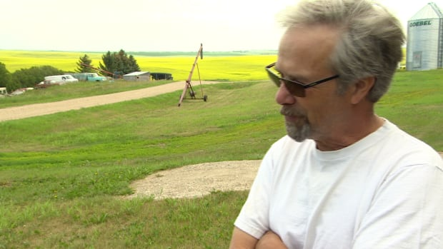 Michel Lepage from St. Denis, Sask. says his canola crops won't produce as much in this year's dry conditions.