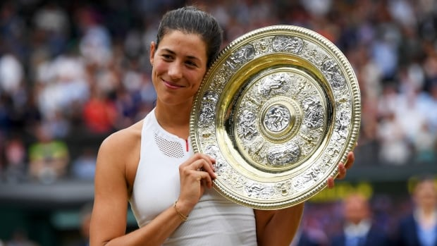 Spain's Garbine Muguruza celebrates her Wimbledon final's victory after defeating Venus Williams of the U.S. in straight sets on Saturday, in London.