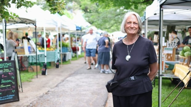 Greer Knox, president of the Ottawa Farmers' Market Association, stands outside her stall at the Westboro market on July 15, 2017.