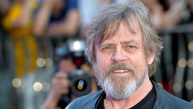 "Mark Hamill, seen here in 2014 at a movie premiere in London, England, was honoured as a Disney ""legend"" alongside the late Carrie Fisher."