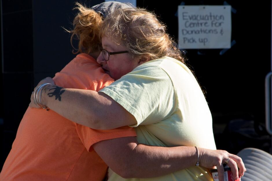 BC Wildfire Kelly Kennedy hugs friend evacuation centre