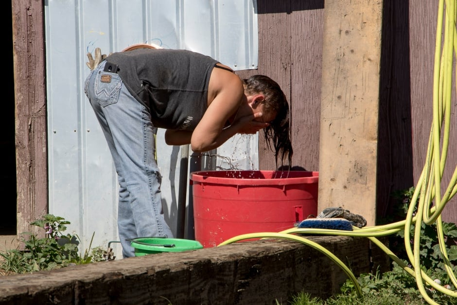 BC Wildfire Evacuees cool down with water