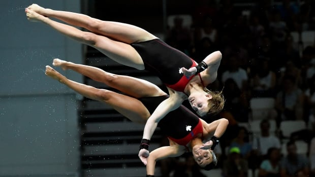 Meaghan Benfeito and Caeli McKay of Canada compete in the women's diving 10m synchro platform at the world aquatics championships in Budapest, Hungary, on Sunday.