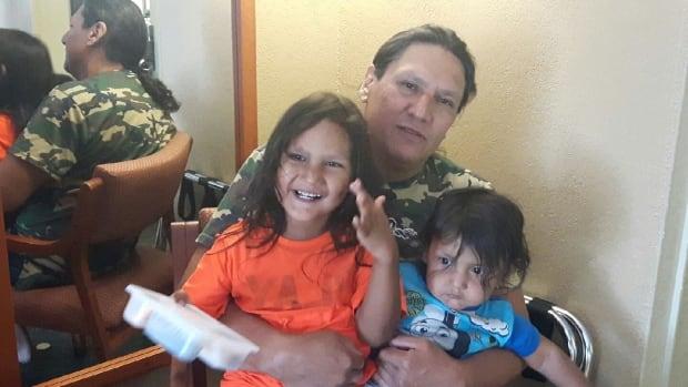 Robert Epp with his children, Freedom, 4, and Mistatim, 16 months.