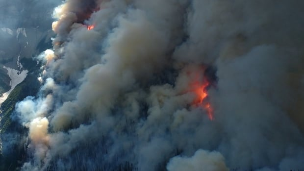 Both the province and Environment Canada are warning Calgarians that smokey skies from the B.C. and Alberta wildfires, like the Verdant Creek fire pictured above, could pose a health hazard as the air drifts eastward.