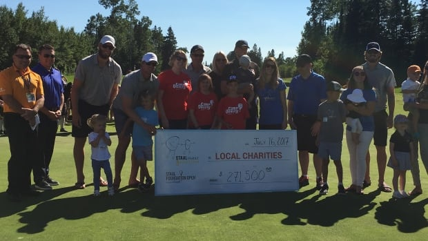 Eric, Marc, Jordan and Jared Staal were among those presenting the cheque to northwestern Ontario charities at the conclusion of the 2017 Staal Foundation Open in Thunder Bay.