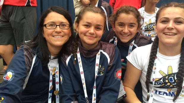 Katrina Haintz attends the 2017 NAIG opening ceremonies with three of her daughters.