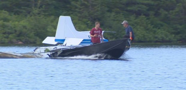 Crashed plane wreckage on boat Paddy's Pond
