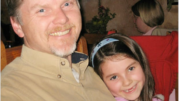 Robert Howard, 49, and his daughter, Veronica, 9, before a semi-trailer accident killed them and Howard's wife and older daughter on a highway in Kootenay National Park on July 22, 2011.