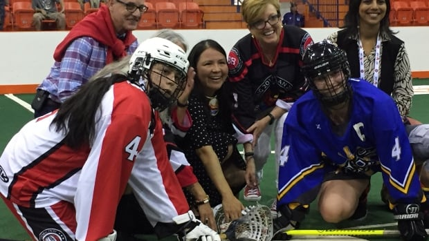 Team B.C. and Team Ontario take part in a ceremonial ball drop before a historic first women's lacrosse match at the North American Indigenous Games on Monday.