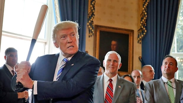 U.S. President Donald Trump wields a baseball bat as he participates in a Made in America product showcase at the White House in Washington, D.C., on Monday. His wish list of NAFTA objectives came as a relief in some quarters.