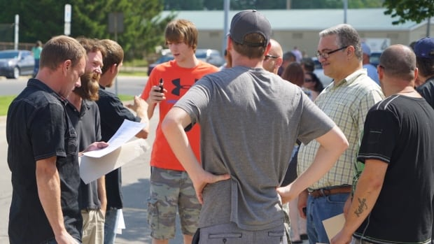 Seimens employees at the Tillsonburg wind turbine plant discuss news that the factory is closing January 2018
