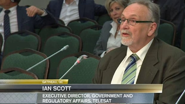 Ian Scott, who has been named the next chair of the CRTC, is shown here delivering remarks to the regulator in his previous role as an executive at Telesat in 2013
