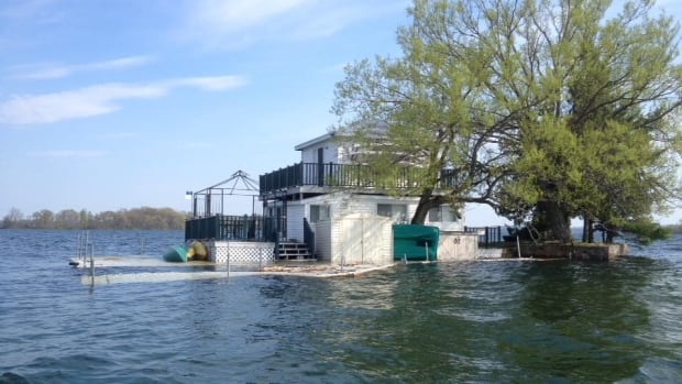 Water rises above the dock of this home on an island near Gananoque, Ont. Water levels on the St. Lawrence Seaway are currently about 75 centimetres higher than normal.