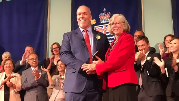 NDP Leader John Horgan smiles after being sworn in as B.C.'s 36th premier by Lt.-Gov. Judith Guichon.