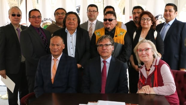 Deputy Chief Rodney Mark, Grand Chief Matthew Coon Come, and Indigenous and Northern Affairs Minister Carolyn Bennett, were surrounded by Cree community chiefs at the signing ceremony in Ottawa Tuesday.