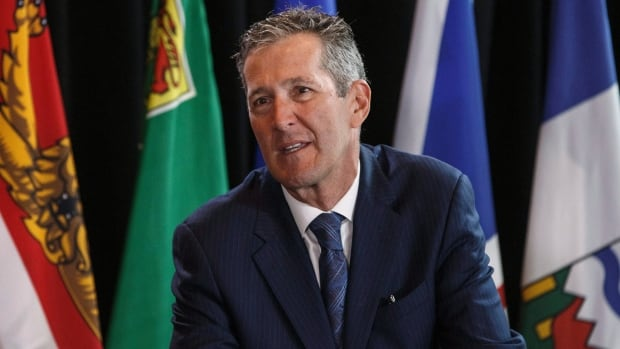 Manitoba Premier Brian Pallister says the new premium would be based on income and would go directly into health-care spending.