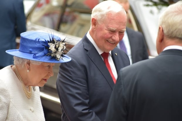 Canada's Governor General breaks protocol by touching the Queen
