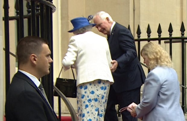 Governor General breaches royal protocol by touching Queen to avoid her stumbling on 'slippy' carpet