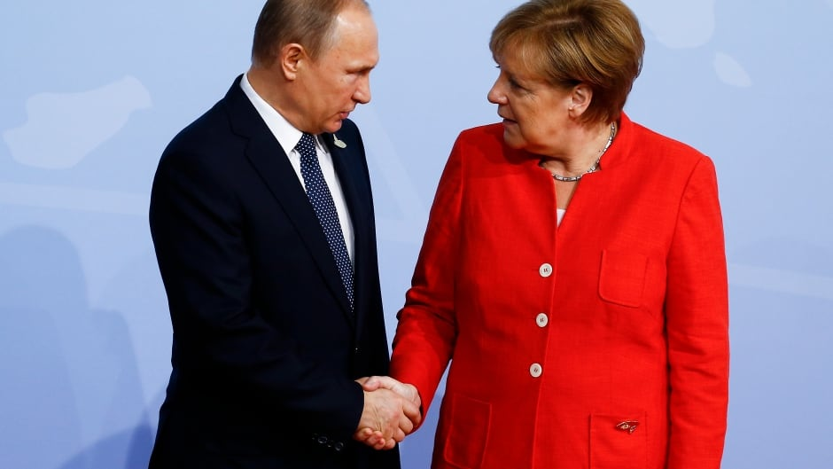 German Chancellor Angela Merkel greets Russian President Vladimir Putin upon his arrival for the first day of the G20 economic summit on July 7, 2017 in Hamburg, Germany.