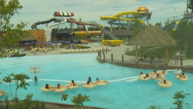The owner of two Calypso water parks says women have to continue to wear swimwear that covers their breasts.