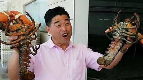 Nathan with lobsters