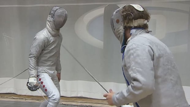 Phil Pitura (left) is with the Regina Rapiers fencing club. He has competed at the World Championships and gave CBC's Peter Mills (right) a lesson.
