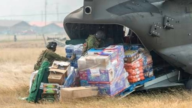 Canadian Forces personnel unload supplies for a community isolated by the B.C. wildfires Wednesday.