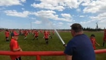 Soccer coach calls in fire department to hose down players
