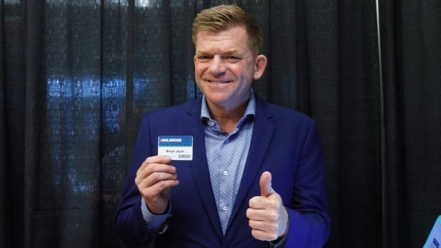 Former Wildrose Leader Brian Jean cast his vote electronically during the Alberta PC/Wildrose merger vote at a special general meeting in Red Deer on July 22.  Jean is now running to lead the new UCP.