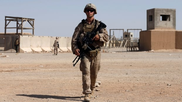 U.S. Marines train Afghan National Army soldiers deployed to fight the Taliban. Helmand province, where the errant bomb struck, remains a flashpoint of violence in the country.