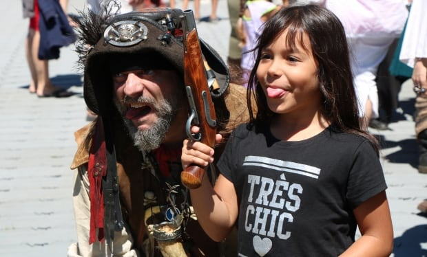 pirate bernard boivin poses with child at quebec city port