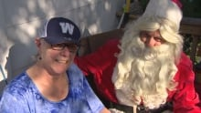 Debbie Peterson gets a suprise visit from Santa during special homecoming on Sunday