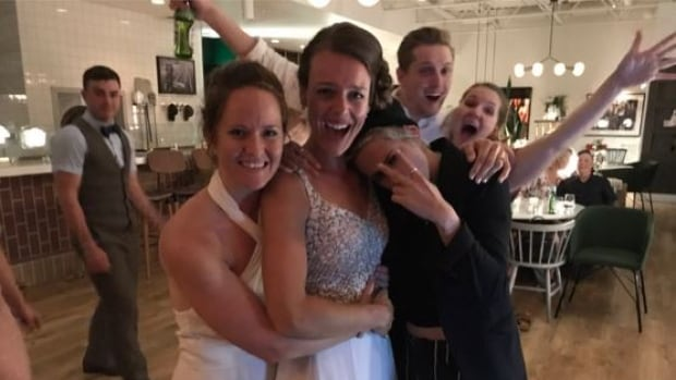 Kirsten (centre) and Kayleigh (left) Jennings were surprised by Hollywood star Kristen Stewart (right) at their wedding on Saturday in Winnipeg.