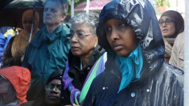 Abdirahman Abdi's neighbours, as well as strangers from across the city, came to mark the anniversary of his death following a violent confrontation with police, and to call for justice.