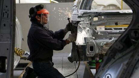 Volkswagen car factory manufacturing plant Mexico welder